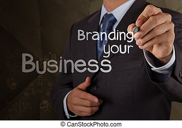 businessman hand writing branding your business with crumpled recycle paper as concept
