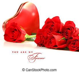 Red roses with box of chocolate on white background