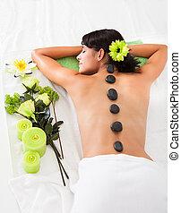 Woman Receiving Lastone Massage - Beautiful Woman Relaxing...
