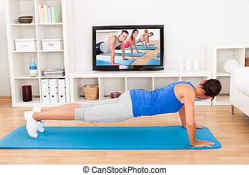 Woman Exercising At Home - Young Woman Doing Pushup In Front...