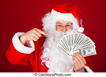 Happy santa holding dollars - Portrait of happy santa...
