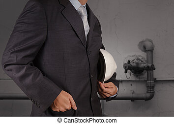 engineer with the piping of an industrial waste water cleaning facility as concept