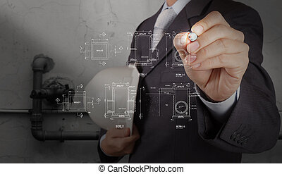 engineer drawing manhole with the piping of an industrial waste water cleaning facility as concept
