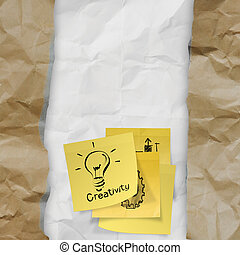 sticky note with  light bulb on crumpled paper as creative concept