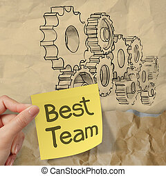 hand hold sticky note with best team word with gear to...