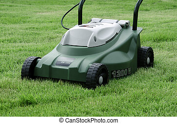 Mowers. - Mowers in the green field.
