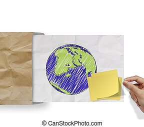 blank sticky note and sketch illustration of planet earth on...