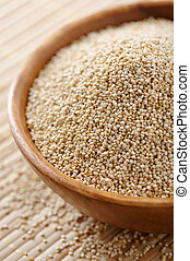 Quinoa seeds - Wooden bowl full of Quinoa seeds