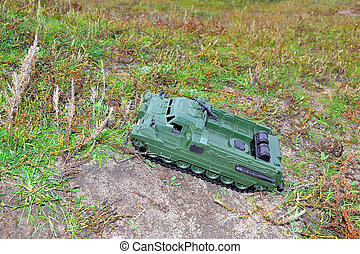 toy tractor, a military truck