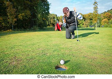 The final blow at golf tournament - Female - golf player on...