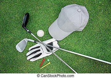 Golf bacground - Golf equipment on green grass