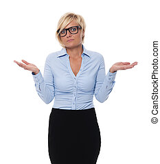 Blonde and beautiful businesswoman shrugging