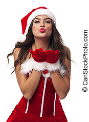 Beautiful and sexy Mrs santa claus blowing sweet kisses