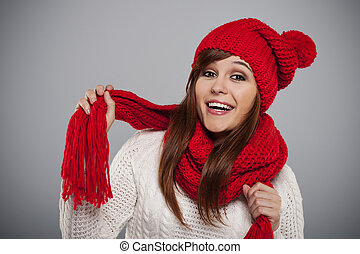 Beautiful young woman wearing red hat and scarf