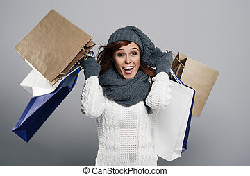 Young excited woman during the winter sale