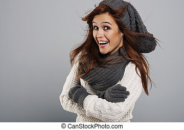 Portrait of happy woman wearing fashion winter clothes