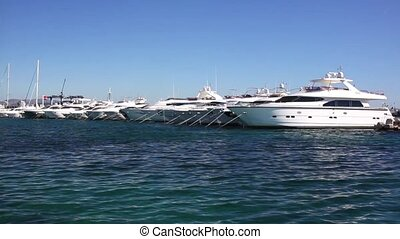 Motor yachts in the harbor - Motor yachts moored in the...