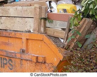 Skip - Orange skip full to the brim of rubbish