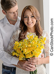 Romantic moment. Portrait of beautiful young couple standing...