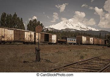Mount Shasta - Freight train in rural area around Mount...