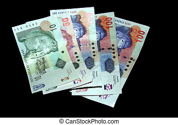 Money on black - South African money isolated on a black...
