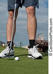 golf ball on green grass prepare