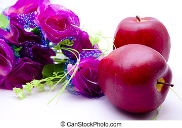 Red apples with roses Strauss on white background