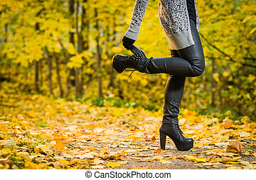 High heels - Girl with a high heels on the park, colors of...