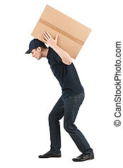 Heavy box. Side view of young deliveryman carrying a big...