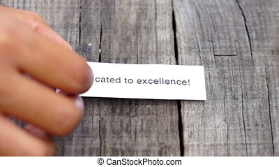 Dedicated Excellence - A Dedicated Excellence paper sign on...