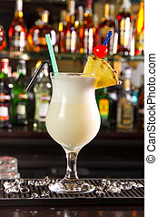 Pina Colada - Pina colada cocktail on a bar counter