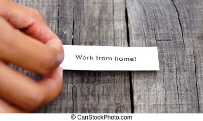 Work from home - A Work from home paper sign on wood...