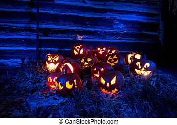 Halloween Pumpkins Lit With Blue Light - Halloween Pumpkins...