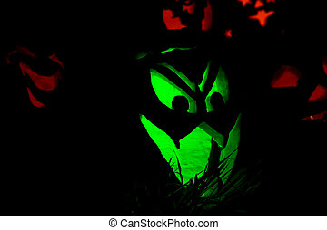 Jack-O-Lanterns Carved for Halloween Lit in Orange and Green