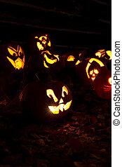 Jack-O-Lanterns Carved for Halloween Lit in Orange