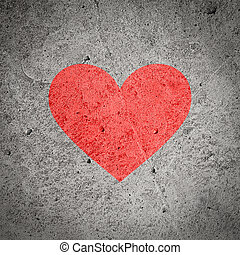 Painted red heart on dark grey grunge concrete and cement wall