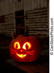 Kitty Cat Jack-O-Lantern on a Picnic Table With Barn