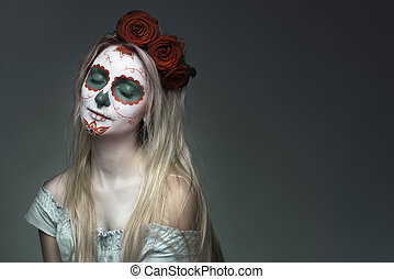 skull face makeup - girl with a skull face makeup
