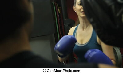 Girl Boxing Training 1 - Handheld, woman doing fitness...
