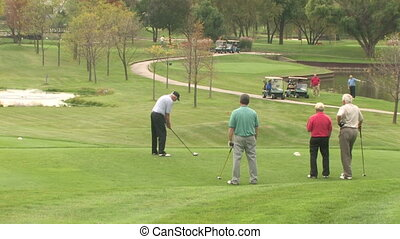 Golfer Unhappy with Swing - A man on the teeing ground...