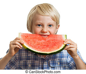 Young boy taking bite of water melon