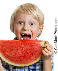 Close-up of boy taking bite of water melon