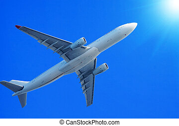 Passenger jet air plane flying on blue sky
