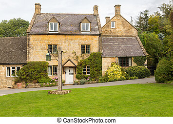 Old houses in Cotswold district of England - Village green...