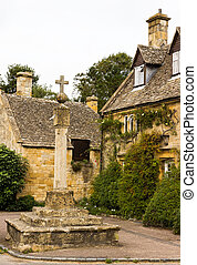 Old houses in Cotswold district of England - Town square...