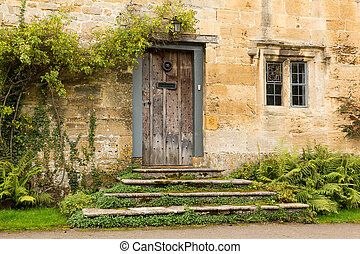 Old houses in Cotswold district of England - Ancient oak...