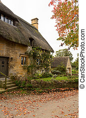 Old houses in Cotswold district of England - Thatched...
