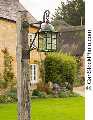 Old houses in Cotswold district of England - Street lamp in...