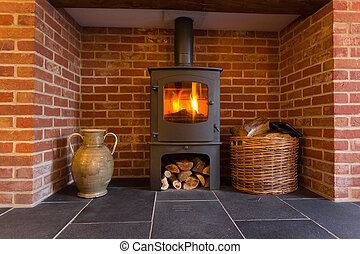 Wood burning stove in brick fireplace - Roaring fire inside...