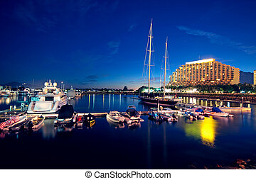 large yachts in the golden coast at night